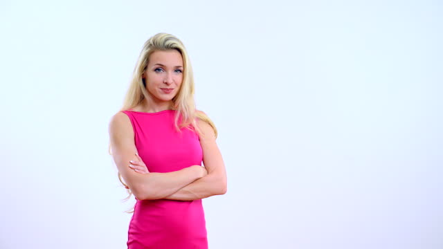 Young beautiful blond woman on white background.