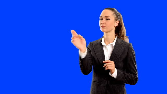 Young beautiful business woman touches the invisible blue and and thinks about the right solution . Close-up