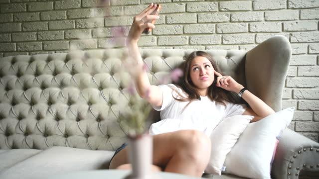 Young beautiful girl doing selfie