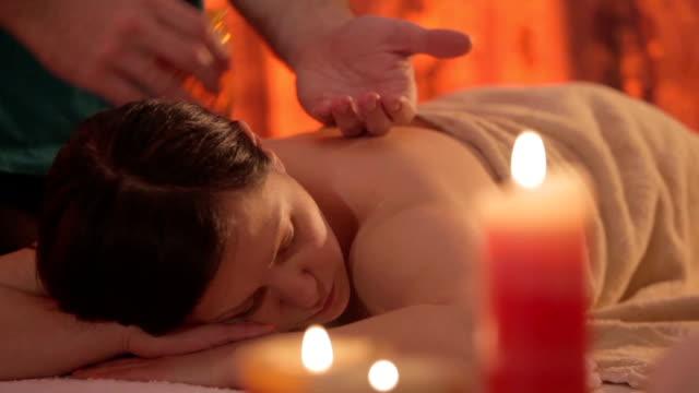 Young beautiful woman getting a massage treatment