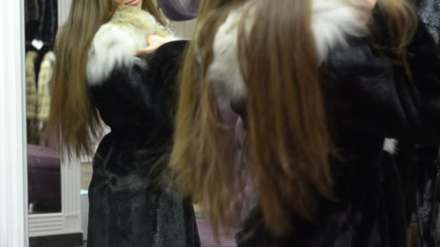 Young beautiful woman tries on clothes at the mall.