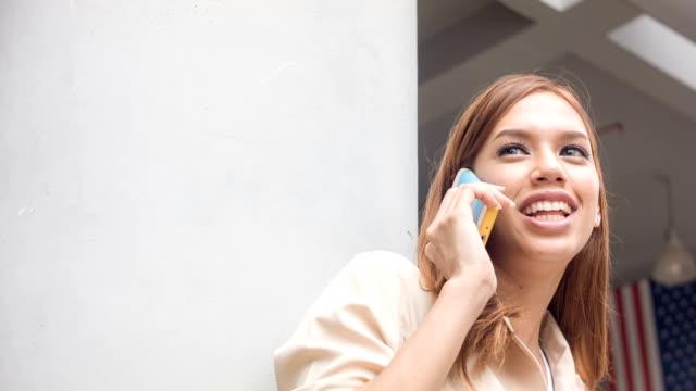 Young beautiful woman using smart phone