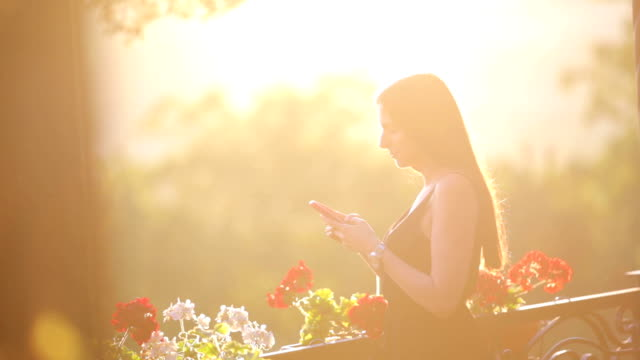 Young beautiful woman using smartphone