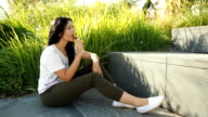 Young beauty woman eating ice cream in the park