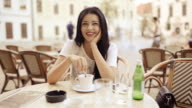 Young beauty woman listening to friend at the table.