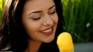 Young beauty woman smiling and eating ice cream.
