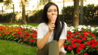 Young beauty woman smiling and eating ice cream