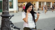 Young beauty woman with mobile phone at the street.