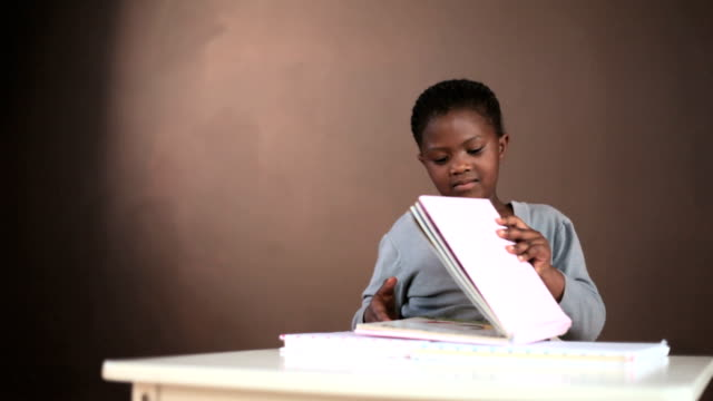 Young black girl reading books