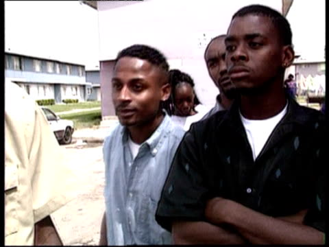 Young black men talking about South Central LA riots On street interviews in aftermath of LA riots on May 05 1992 in Los Angeles California