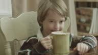 Young boy enjoys hot cocoa