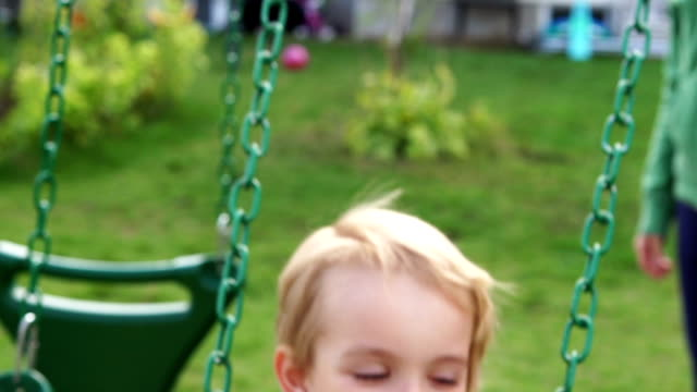 Young boy on a swing - 1080HD Super Slow Motion