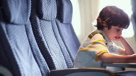 Young boy sitting on aeroplane