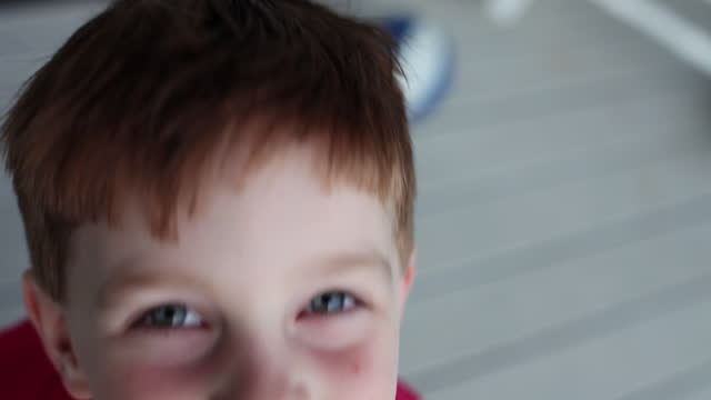 A young boy smiles for the camera.