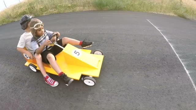 Young Boys Racing Homemade Soap Box Race Car