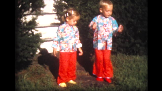 1959 young brother and sister in matching Chinese Pajamas