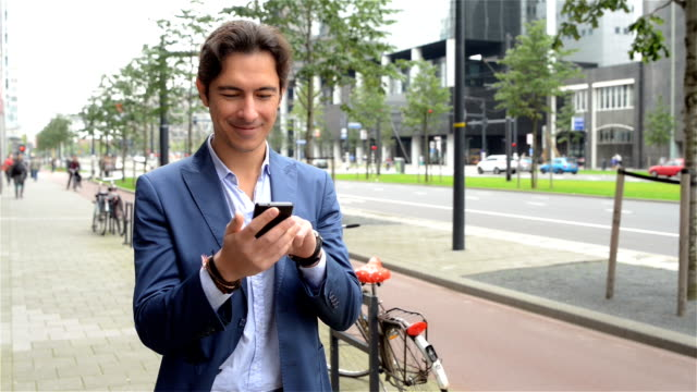 Young business man texting