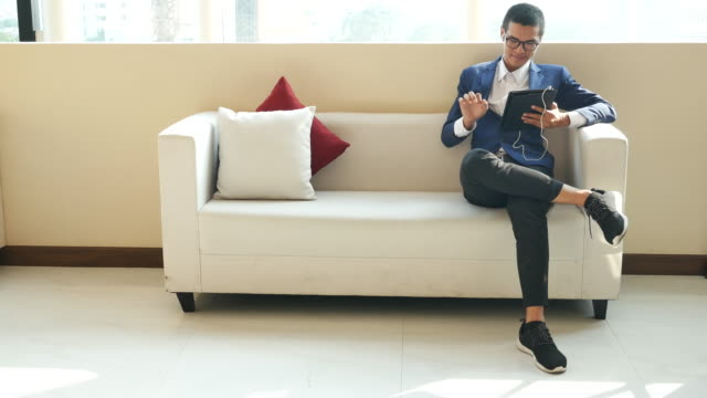 young business man use tablet on sofa