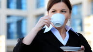 Young business woman drinking coffee.