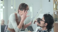 Young business woman yelling at colleague