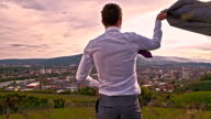 SLO MO Young businessman enjoying the view