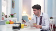 Young businessman having a breakfast at home