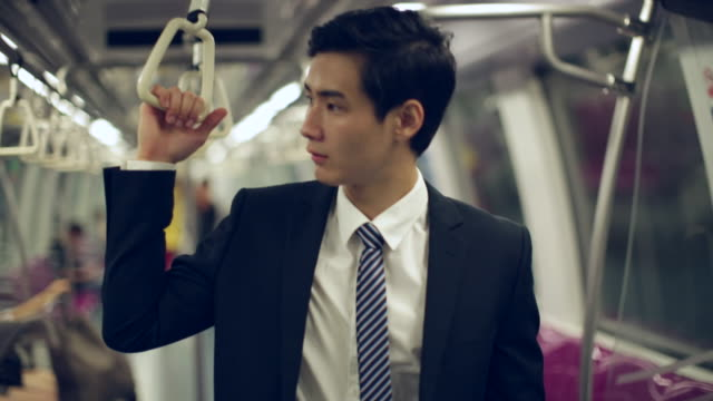 MS Young Businessman on standing up on subway train