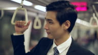 CU Young Businessman on subway train