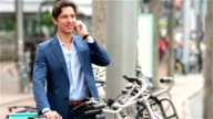 Young businessman parking his bicycle