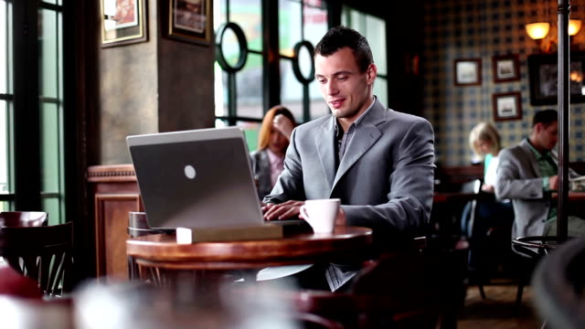 Young businessman typing at laptop