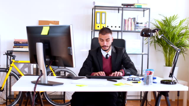 Young businessman working on computer