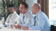 HD: Young Businessmen Having Conversation In Restaurant