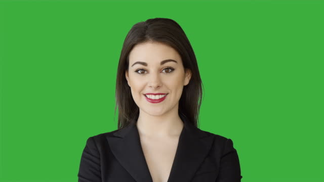 Young Businesswoman Standing against a Green Background. Financial Employee Acting in Front of Green Screen for Chroma Key.