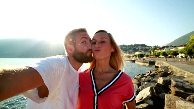 Young cheerful couple taking a selfie using a mobile phone