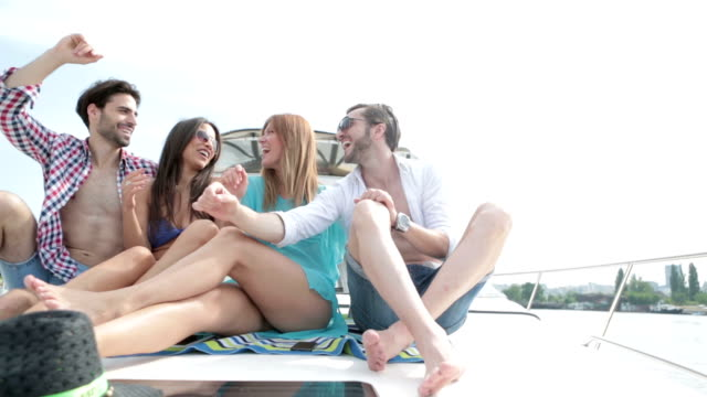 HD: Young Cheerful People Yachting Together.