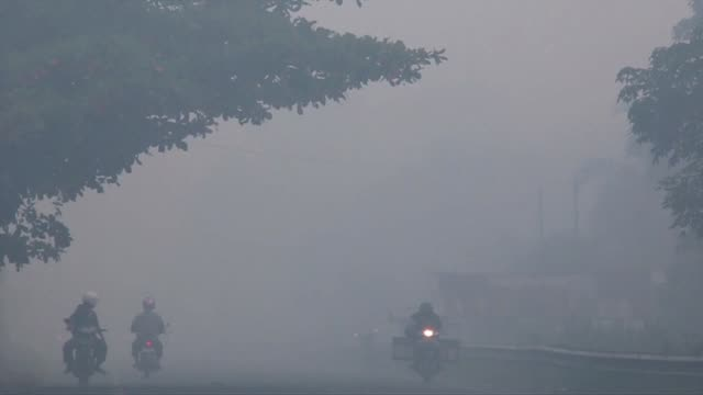 Young children lie in hospital in Aceh province Indonesia as thick smoke caused by forest fires forces dozens of people to be treated for lung...