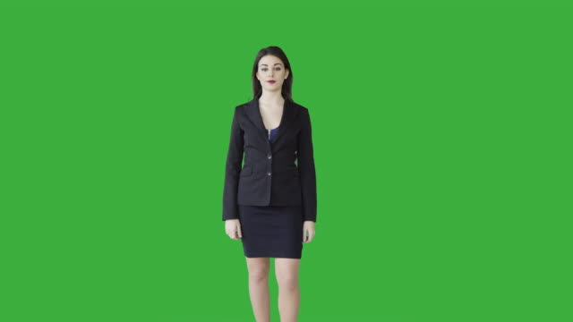 Young Confident Businesswomen Standing Against Green Screen Background. Attractive Female Professional Model Isolated on Chroma-Key.