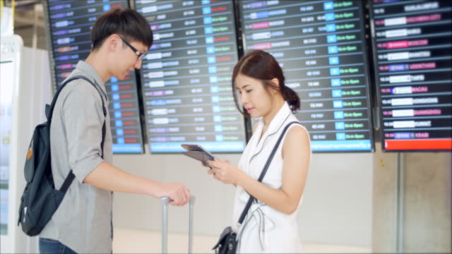 Young Couple checking airport  flight