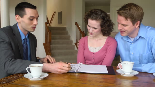 Young Couple Discuss Finances with Male Professional