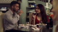 MS Young couple drinking wine in restaurant