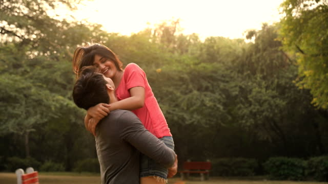 Young couple enjoying in the park, Delhi, India