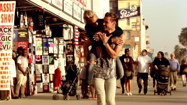 Young Couple Flirting Venice Beach Los Angeles.