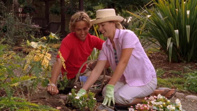 CU, TU, ZO, Young couple gardening, Cambria, California, USA