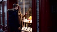 Young couple having fun shopping in the city