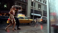 SLO MO, MS, LA, Young couple hugging on street in rain, New York City, New York, USA