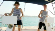 Young couple in a fight at the helm sailing yacht
