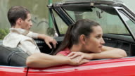 Young couple in convertible