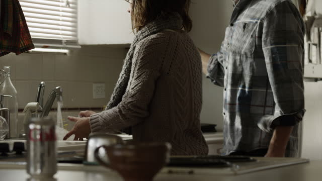 MS Young couple in kitchen / Provo, Utah, USA