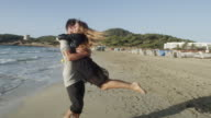 young couple in love enjoying time together at a beach