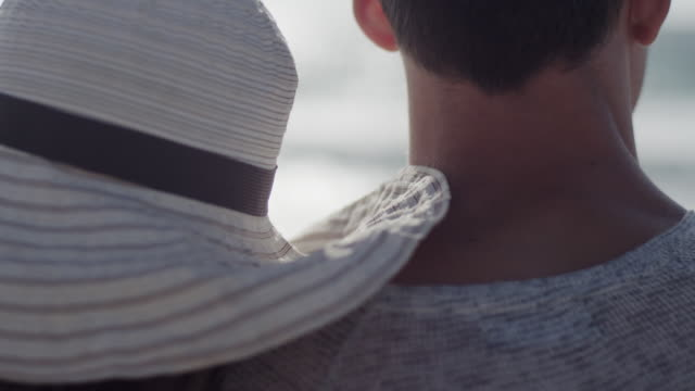 young couple in love enjoying time together on a beach - multiple shots available